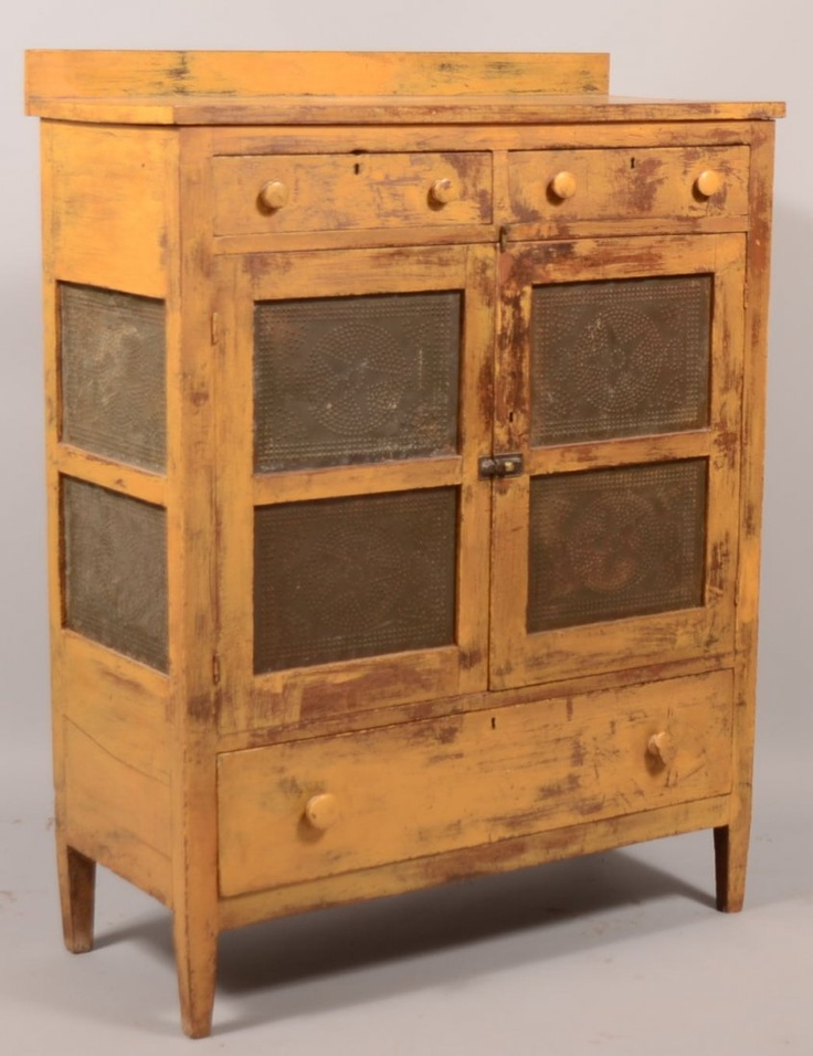 19th. Century Yellow Painted Walnut Punched Tin Pie Safe...