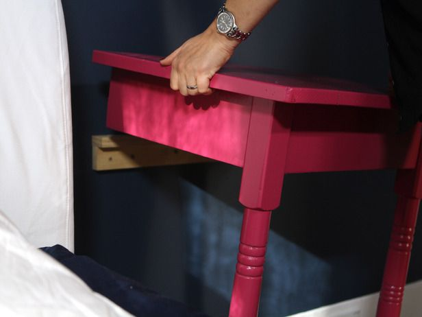 Creative and Chic DIY Nightstands : Cut a table in half and mount to to the wall to create two nightstands : HGTV