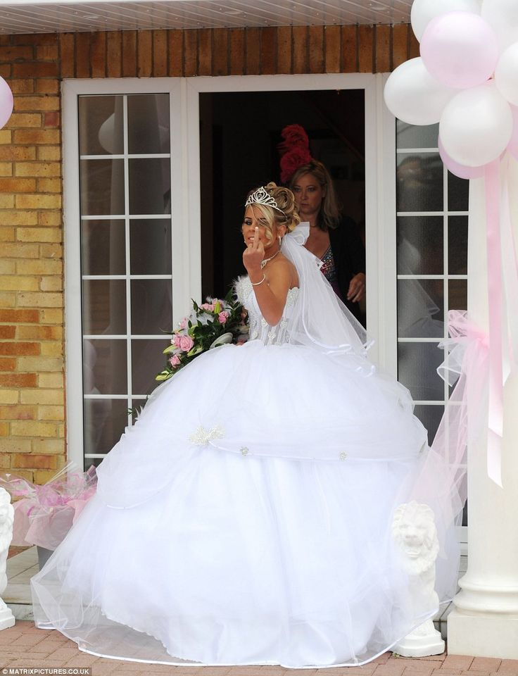 Charming! Gypsy bride Cheyenne Pidgley, 16, got married in typically lavish style today in the village of Hersham, Surrey, while cameras fil...