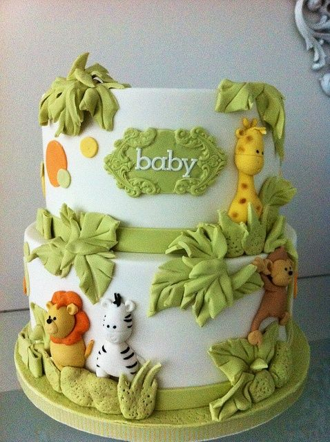 "Cute ""jungle"" themed cake for a baby shower or child' s birthday."
