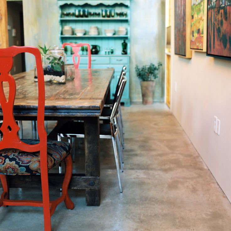 Dining Area With Painted Hutch, Gallery Wall, Rehabilitated Chairs, And  Concrete Floor.