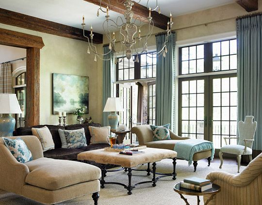 The home of former Atlanta Braves shortstop Jeff Blauser and his family is an enchanting blend of Southern elegance and down-home Southern hospitality. A multi-arm Italian chandelier hangs above the ottoman, balancing the large room without dominating it.