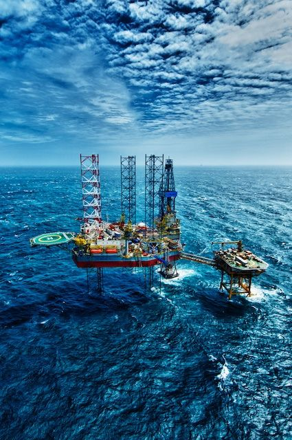 Thu & Mads can even make an ugly thing like an oil rig look beautiful! On assignment in Vung Tau by Thu & Mads, via Flickr