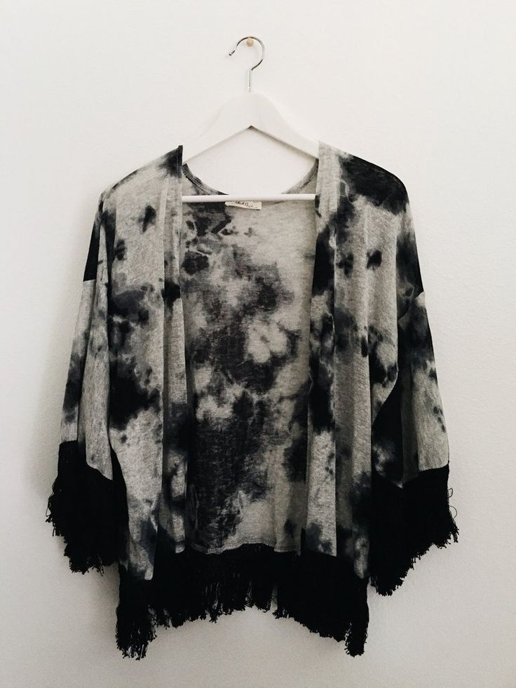 """This tie-dye print kimono features an open front and tassel trimmed hem. Fabric Content: 100% POLYESTER Description: L: 19"""" B: 54"""" W: 58"""""""