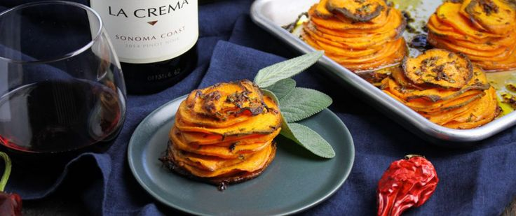 Potatoes are a must-have at Thanksgiving whether they're mashed, roasted or dressed with butter like this recipe for Chipotle Sweet Potato Pommes Anna.