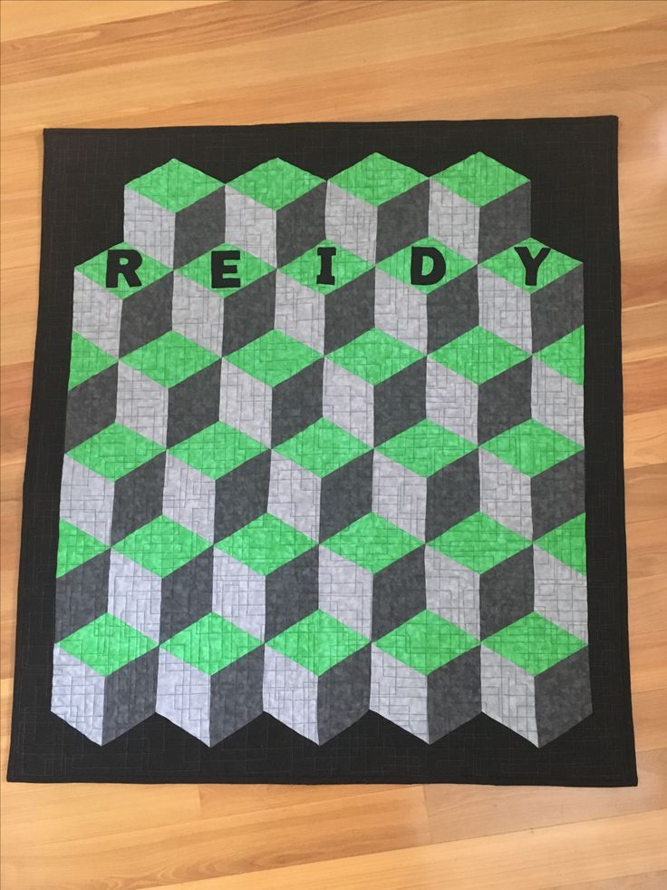 Quilt 34. Reidy House Quilt for St Joseph's College Gregory Terrace Brisbane. Missouri Star Quilt Company design of rhombus. Made with green, gray and black mottled fabric and quilted free motion blocks.
