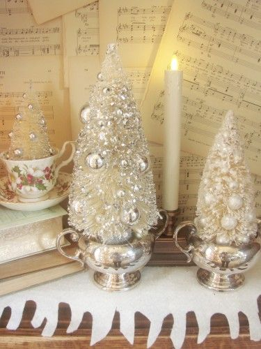 You can bleach your own Bottle-brush trees After they're bleached and dried, take a foam paint brush and dab on globs of Mod Podge, then roll in glitter, use hot glue to add jewels, beads and balls and tuck them into a china tea cup, or silver cream and sugar servers.: