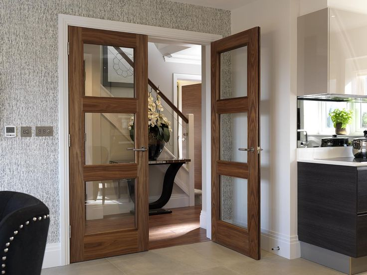 Gorgeous walnut glazed #doubledoors. Bespoke option by JB Kind Doors #walnutdoors Fitted at a Heronslea Development in North London