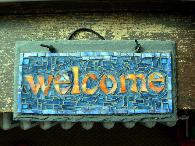 """Mosaic Welcome Sign in Orange and Blue by Nutmeg Designs  Youghiogheny glass, recycled glass tile, and gold smalti on slate, 12x6"""""""