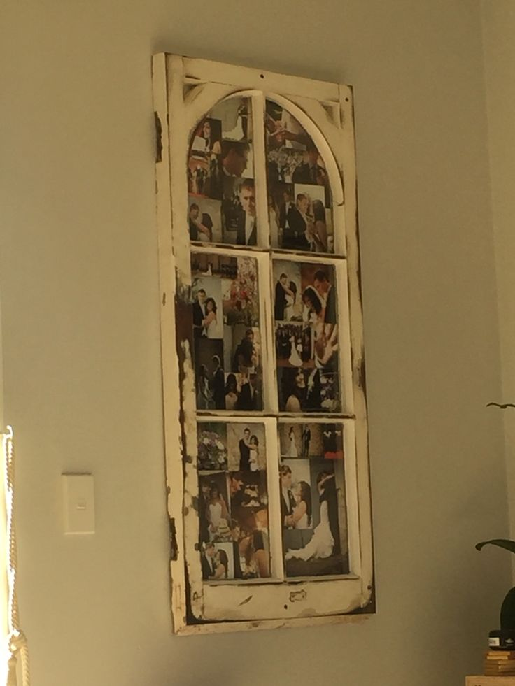 Old window frame turned into a photo frame.
