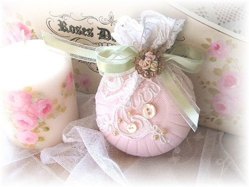 Rose scented soap covered with lace sachet, via Flickr.