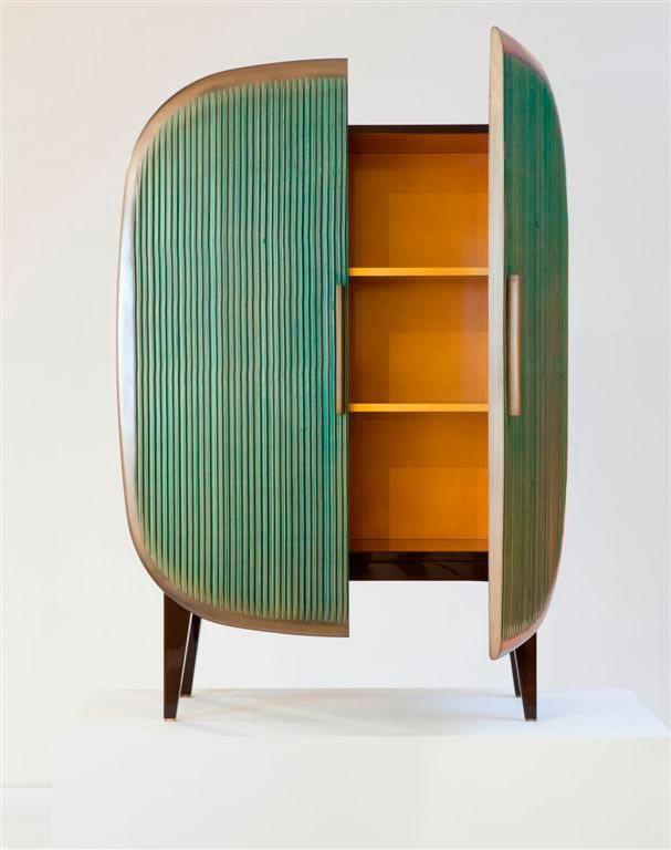 "pic 2 of 2. gorgeous! needed to enliven a room full of neutrals. ""Scarab"" Cabinet by Patrick Naggar, available via Ralph Pucci."