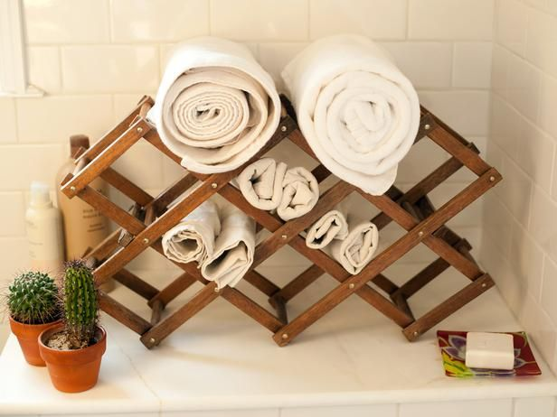 Accordion Wine Rack: Perfect for the guest bathroom so they don't have to search for a towel. http://www.hgtv.com/decorating-basics/clever-uses-for-everyday-items-in-the-bathroom/pictures/page-2.html?soc=pinterest