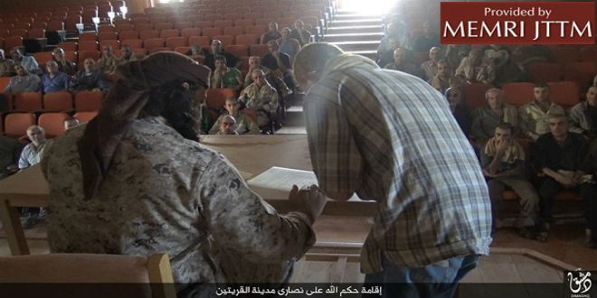 """ISIS published photos of the terror group forcing Syrian Christians to sign a contract that forces them to pay a """"jizya"""" tax and severely curtails their freedom to practice their faith."""