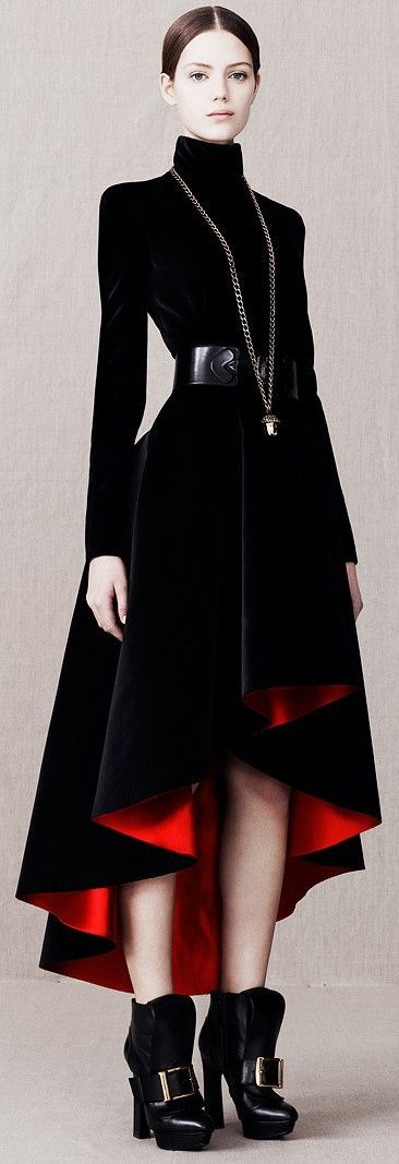 Black turtleneck dress with slim top and full high-low skirt that is lined in a dramatic red satin. Alexander McQueen Pre-Fall 2013. Photo source: Vogue.