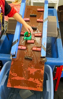 """WATER TABLE RAMP: This is a great activity for fun, math and science skills. It allows children to play while learning about probability. Children may wonder, """"if I pour/tilt it down this end, will it flow on the left side or right side?"""""""