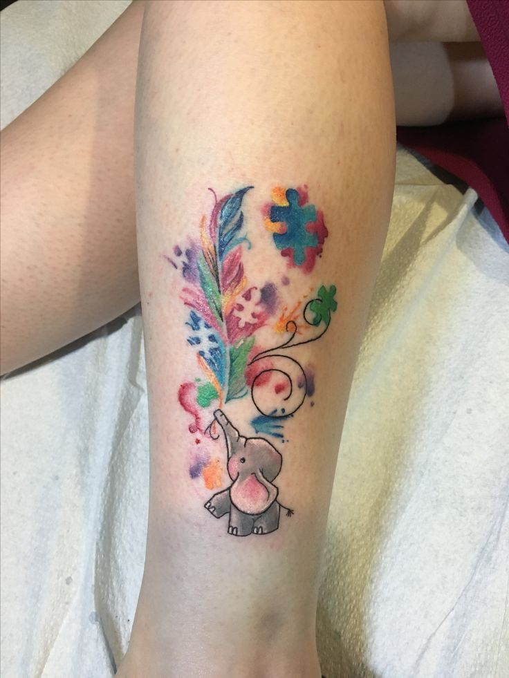 My new tattoo. It's a combination of a few ideas I saw & liked. An elephant holding a feather with autism puzzle pieces coming out of the feather.