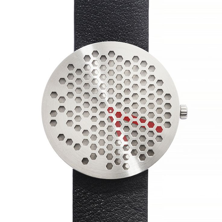 A punctured surface is a signature feature of Scandinavian designer Alexander Lervik's work.   The Bikupa watch's dial partially conceals its face. Red hands denoting minutes and hands peek through the holes.