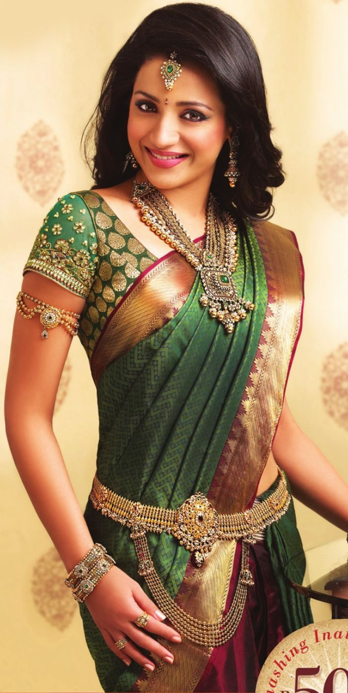 Tamil-Trisha. really simple yet beautiful accesories, the waist belt, necklace.