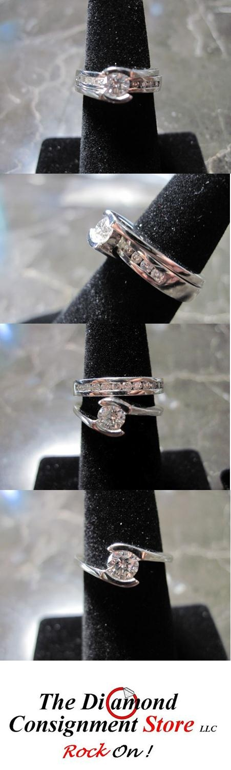"""Bridal set. This set is called a """"bypass"""" because the wedding band passes through the engagement ring to make this beautiful combination. This PLATINUM set contains a 1.2 ct round center diamond with 11 round diamonds in the wedding band. $2830    #thediamondconsignmentstore #platinum #engagement #bridal #diamond #gift #discountjewelry #bridalset #bling #beautiful"""