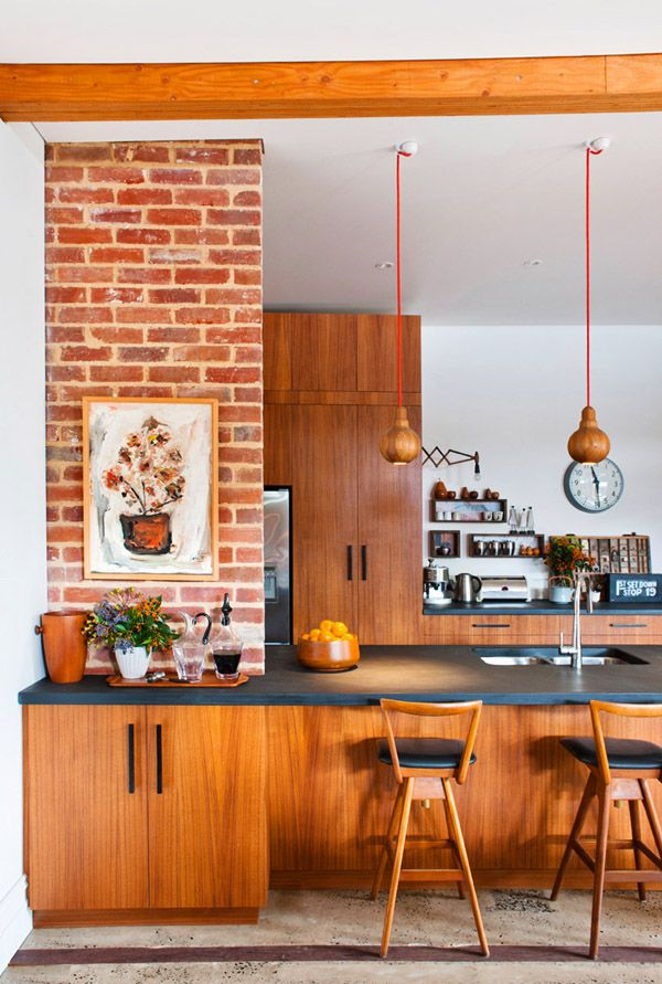 love those wide countertops and all that wood! wood pendants too!