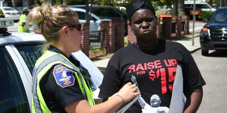 CHARLESTON, S.C. -- About two dozen of this city's fast-food workers marched Thursday afternoon to a street corner that's home to a McDonald's, a Wendy's and a KFC. Calling for a living wage of $15, they seated themselves in the middle of a freeway e...