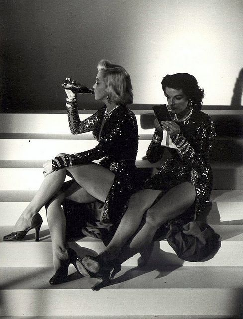 Marilyn and Jane taking a break during the filming of Gentlemen Prefer Blondes. What icons!