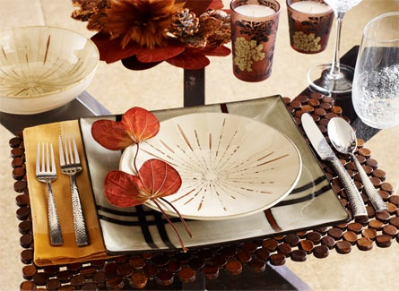Pier 1 - Cool faux Asian look - Bamboo Beaded Placemat • Ashton Square Dinner Plate • Sanctuary Salad Plate • Sanctuary Bowl • Wheat Yellow Hemstitch Napkin • Paris Hammered Flatware • Angled Rim Wine Glass and Tumbler • Copper Floral Filled Candle • Brown Butterfly Leaves Bunch
