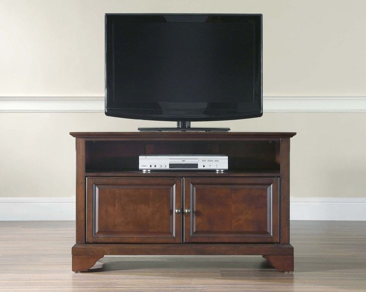 LaFayette 42 Inch TV Stand in Vintage Mahogany is a part of LaFayette Collection by Crosley    Constructed of solid hardwood and wood veneers, this cabinet is designed for longevity. The rich, hand rubbed, multi-step Vintage Mahogany finish is perfect for blending with the family of that is already part of your home. Antique Brass finish hardware adds a touch of style to this already beautiful cabinet. There is plenty of storage space and wire ma