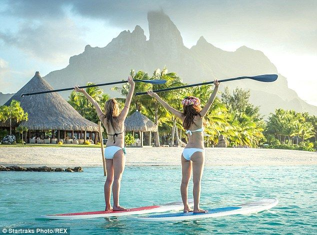 Enjoying the view: Maria and her pal did a number of stretches as they took in the stunnin...