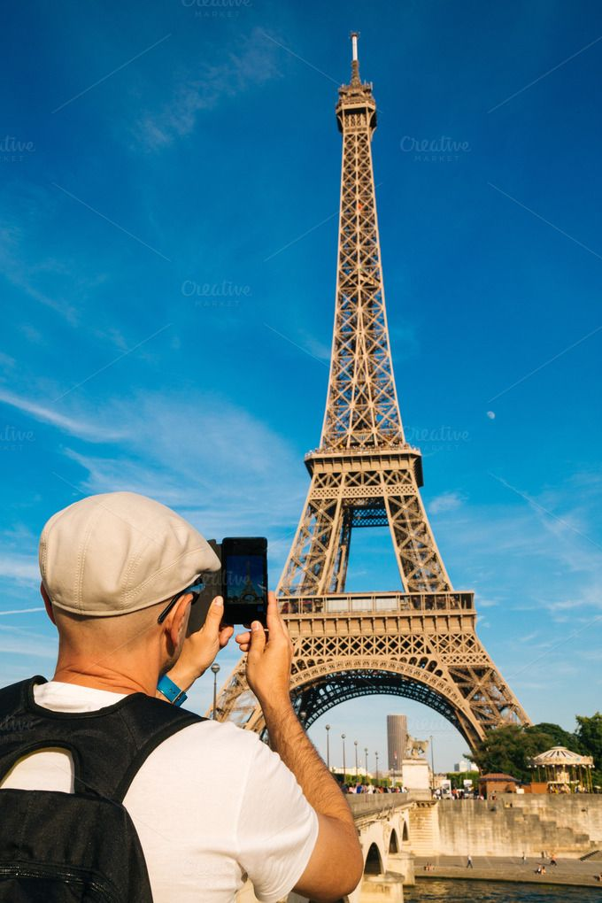 Taking pictures of Eiffel Tower by asife on Creative Market