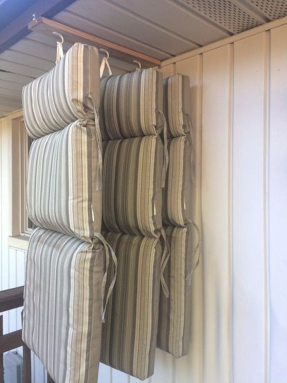 this man came up with a clever storage idea for his porch cushions see how to do it with hooks from walmart