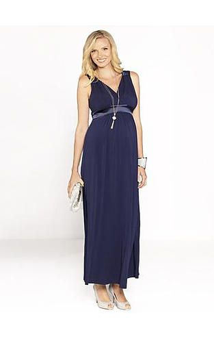 This elegant evening dress allows for a comfortable loose flowing skirt while creating shape by defining the slim line under the bust with a satin belt and emphasising the bust with a form fitting v neck line.  Photo credit- roomfortwo.com.au