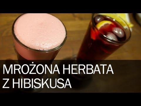 """Poradnik: Jak zrobić dobrą mrożoną herbatę Ice Tea domowym sposobem z Hibiskusem Hibiskus to bardzo kwaśna i zdrowa roślina, prosto z Egiptu, gdzie jest narodowym napojem. Parzenie hibiskusa jest proste i można to robić na dwa sposoby. Można zalać wrzątkiem i parzyć 8 minut lub zalać zimną wodą i """"parzyć"""" nawet kilka dni."""