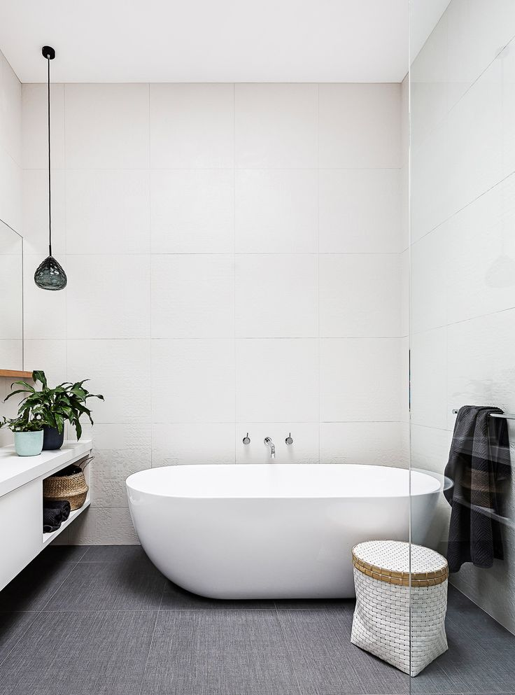 "Floor and wall tiles with a subtle textural finish give this contemporary bathroom added warmth. See more of this [modern-classic Victorian cottage renovation](http://www.homestolove.com.au/gallery-rachel-and-martys-modern-classic-victorian-cottage-renovation-1978|target=""_blank""). Photo: Maree Homer / *homes+*: [object Object]"