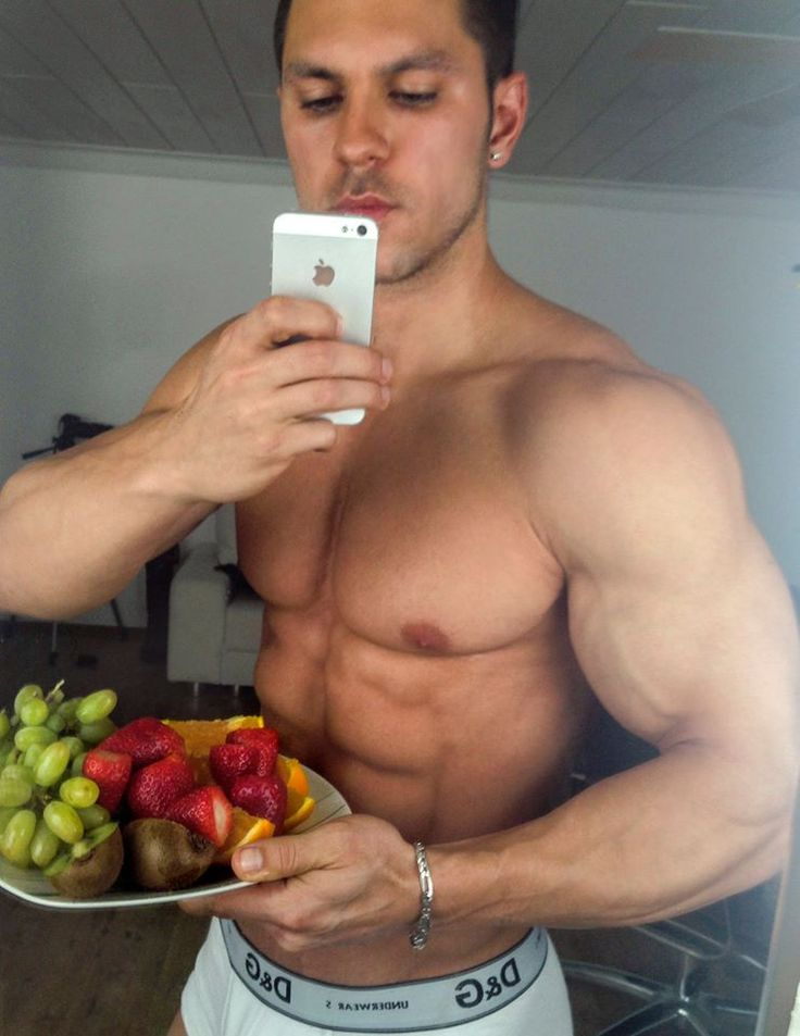 Alon Gabbay in a shirtless mirror selfie with fruit salad