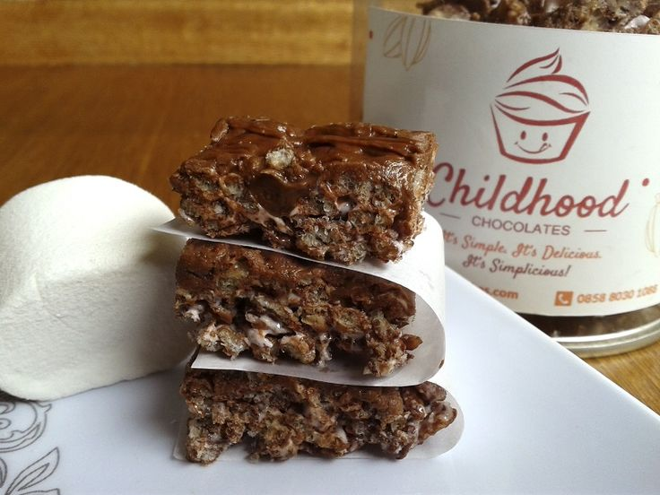 Choco Marsh Crispy Bars are crispy rice cereal bars made with marshmallows and a layer of chocolate for a sweet spin on a childhood favorite.  Visit our online store at childhoodcakes.com     #chocolate #marshmallows #crispy #bars #childhood #childhoodcakes