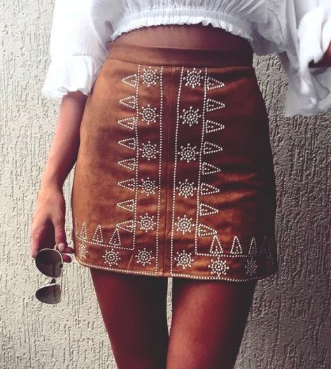 A Bohemian Embroidery Skirt from Pasaboho. This skirt exhibit brilliant colours with tribal embroidered patterns. Inspired from the latest boho chic fashion style.