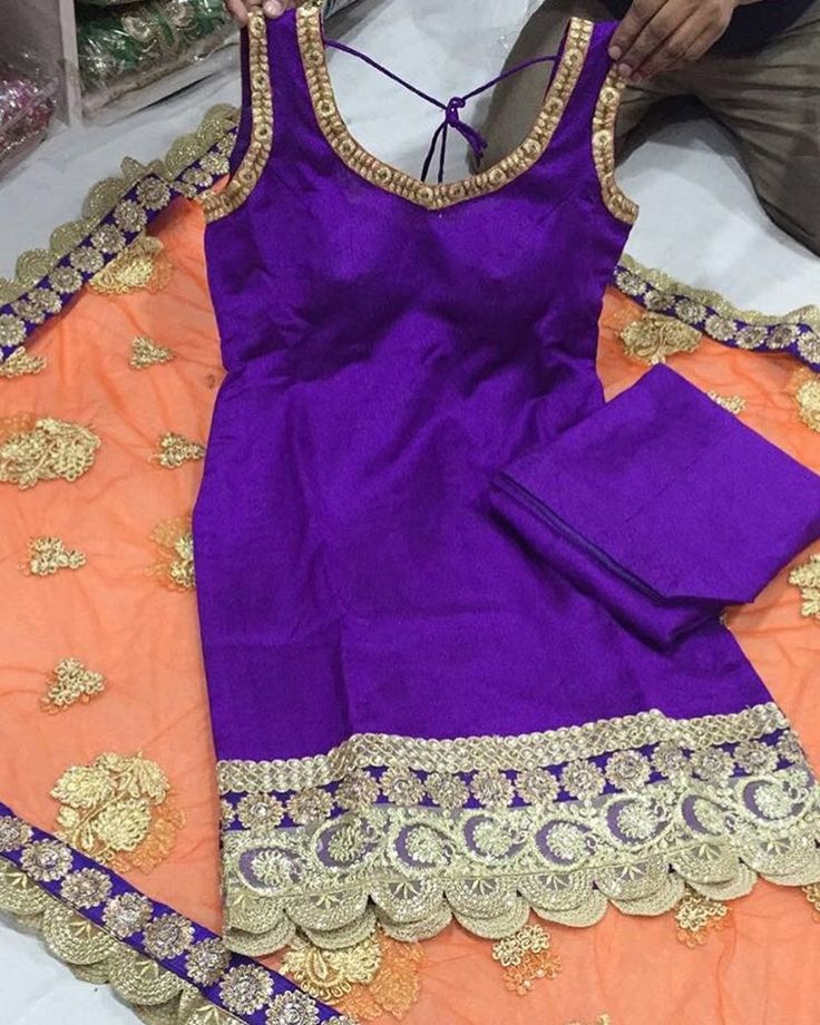 This peach/purple combination by Vastra Bazaar screams summer to me! I love it! The minimal embroidery also makes this suit so easy to carry.
