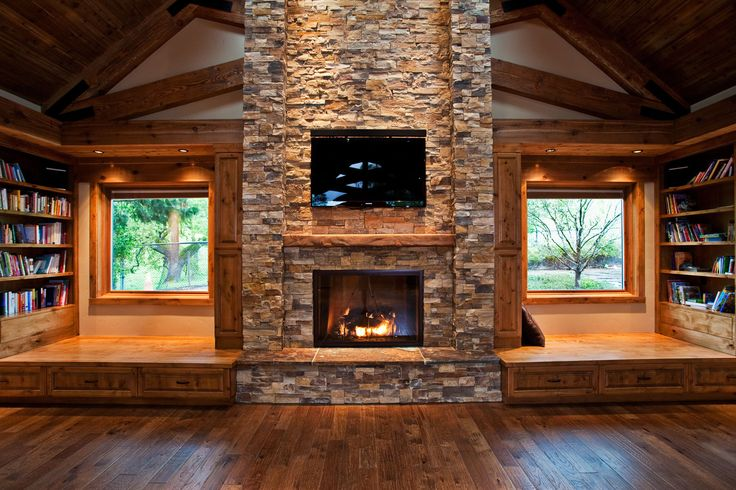 Awesome Stone Fireplace Library. I like the raised floor. Could put nice chairs, or even small mats for guest sleeping/yoga.