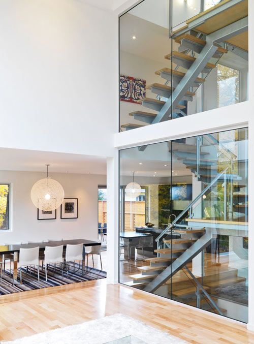 LightHouse, designed by LineBox Studio, is located in Ottawa, Canada and built for a family of five. The house is vertically stacked and situated around a glass-enclosed staircase made of steel and maple.