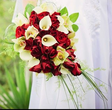 Stunning Red roses, white calla lilies and Green cymbidium orchids with beer grass and asparagus fern. www.flowerz.co.nz