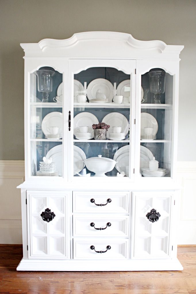 This gorgeous china hutch started out as a veneered wood goodwill piece !!! (incredibly daunting) but turned out SO inspiring. She painted the backboards an accent blue and spray painted the hardware a dark oil rubbed bronze. Great for display on top and extra storage on the bottom.