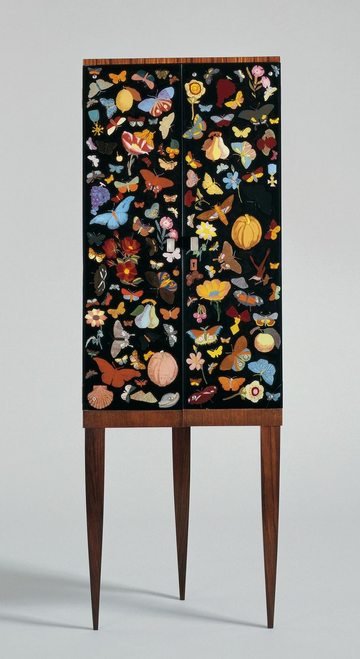 // Cabinet with Reverse-Painted Glass Doors, 1941.