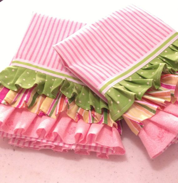 "Cotton tea towels with ruffled trim. Pink and white stripes with festive accent color ruffles and grosgrain ribbon.  Each towel measure 17"" X 19""."