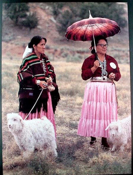 Navajo women and Angora goats.