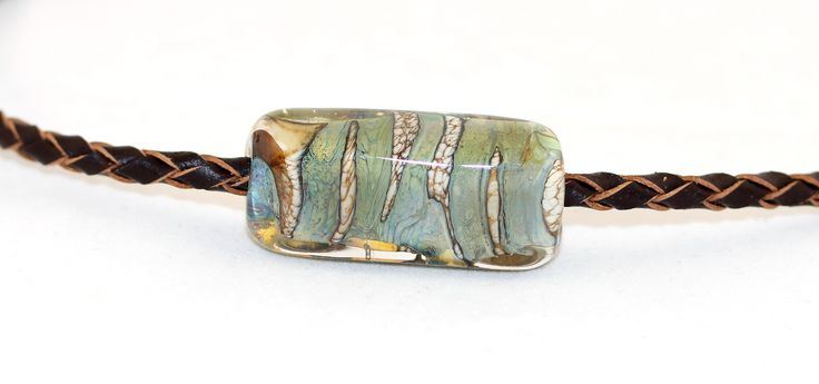 Men's necklace. I created a square formed glass bead and used real leather cord.