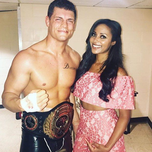 Former WWE Superstars Cody Rhodes (Cody Runnels) and his wife Brandi Rhodes (Brandi Reed Runnels) celebrating his Ring Of Honor championship #WWE #ROH #wwecouples