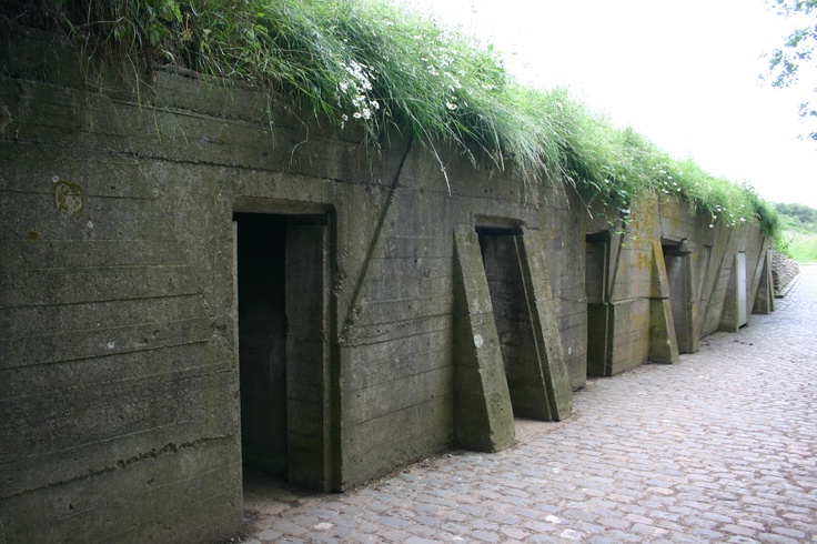 "Bunkers adjacent to Essex Farm Cemetery, Ypres, Belgium.    It was here that Lieutenant Colonel John McCrae, serving as a doctor in this dressing station, wrote ""In Flanders Field""."