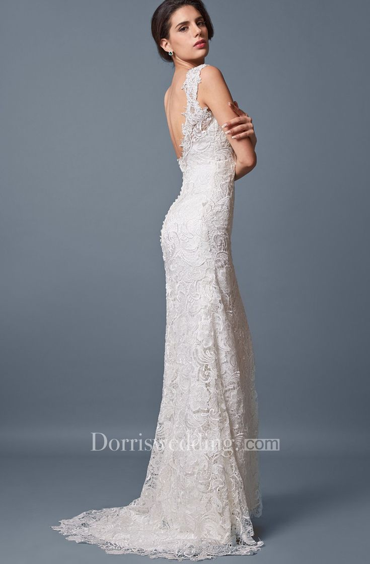 <br />Slip into a statement of elegance with this stunningly slim wedding gown with off-the-shoulder lace neckline. Delicate, beautiful lace is layered over every inch of this gorgeous gown, the lace extending above the bodice into a distinctive sheer off-the-shoulder neckline. .